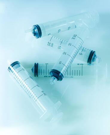 Group of syringes on blue background