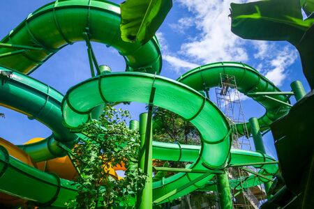 Water slides in an aquapark. Blue sky background