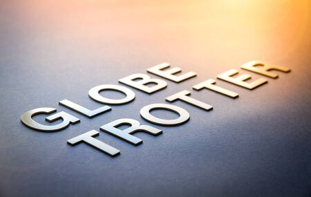 Word globe trotter written with white solid letters on a board