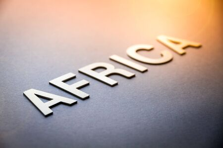 Word Africa written with white solid letters on a board