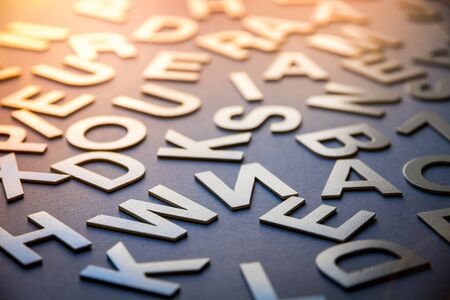 Mixed solid letters pile closeup photo. Education background concept