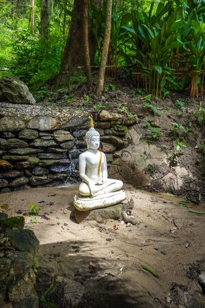 White Buddha statue in jungle, Wat Palad, Chiang Mai, Thailand