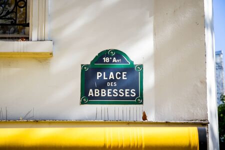 Place des Abbesses street sign in Paris, France