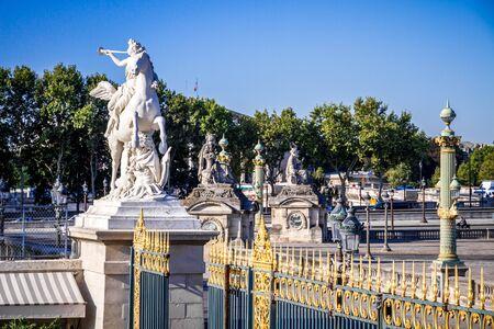 Fame straddling Pegasus statue and the Tuileries Garden entrance gate, Paris, France Standard-Bild