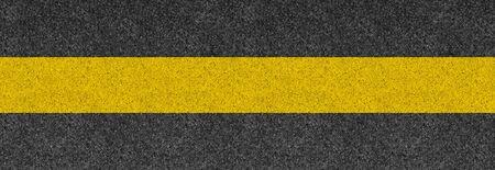 Black asphalt background texture with horizontal yellow line. Banner