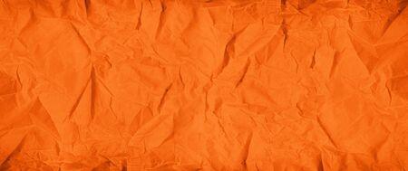Old orange crumpled paper texture background. Wallpaper banner Stockfoto