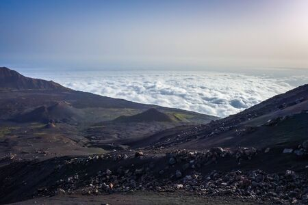 Cha das Caldeiras over the clouds view from Pico do Fogo in Cape Verde, Africa