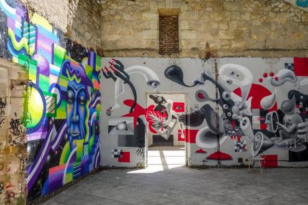 Bordeaux/France - April 18, 2018 : Graffitis in Darwin old buildings, Caserne Niel.