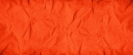 Old red crumpled paper texture background. Wallpaper banner