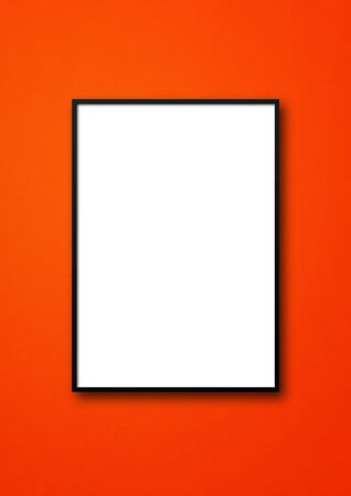 Black picture frame hanging on a red wall. Blank mockup template 免版税图像