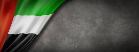 United Arab Emirates flag on concrete wall. Horizontal panoramic banner. 3D illustration 스톡 콘텐츠