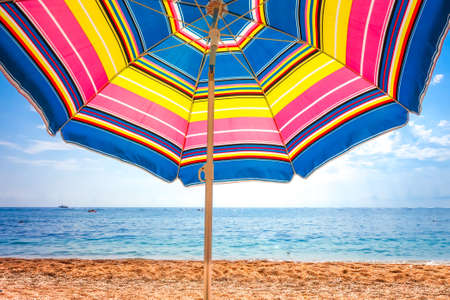 Colorful umbrella close-up view on a tropical beach Standard-Bild - 155540984