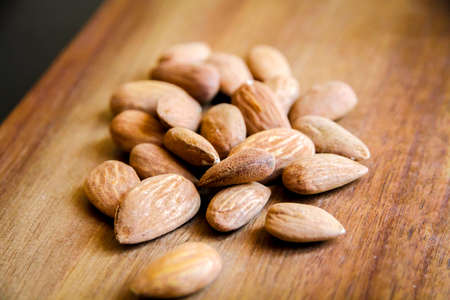 Fresh organic almonds on a wooden cutting board Standard-Bild