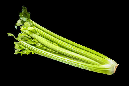 Celery branch bunch isolated on black background. Top view Standard-Bild