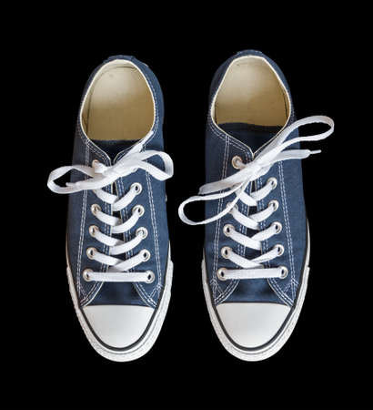 Blue generic sneakers isolated on black background Standard-Bild