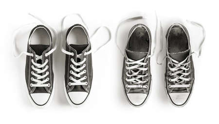 New and old black generic sneakers isolated on white background Standard-Bild