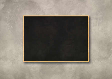 Traditional black board isolated on a concrete background. Blank horizontal mockup template