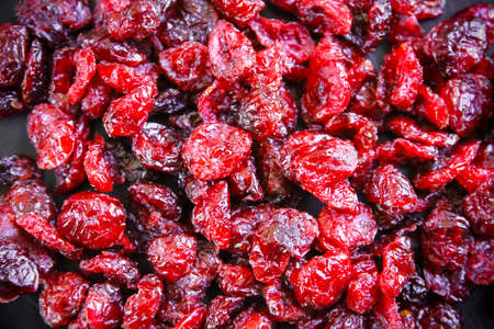 Dried cranberries background texture wallpaper. Top view Standard-Bild