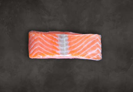 Salmon steak on concrete board background. Top view