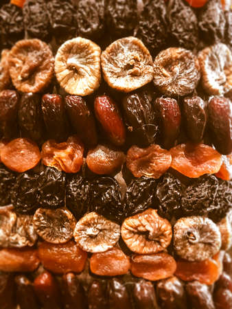 Organic dried fruits background made of figs, dates, prunes and apricots
