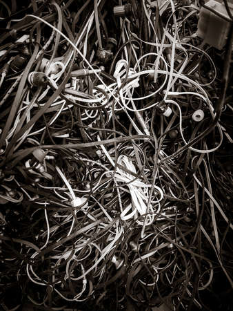 Old mixed electric wires. Black and white wallpaper background