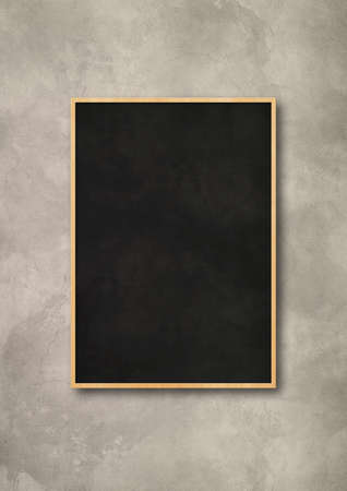 Traditional black board isolated on a concrete background. Blank vertical mockup template