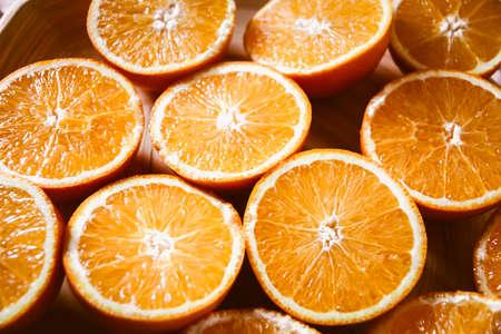 Bunch of fresh organic sliced oranges on a tray Standard-Bild