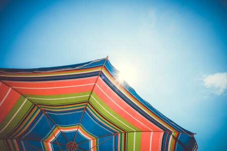 Colorful umbrella close-up view on blue sky Standard-Bild