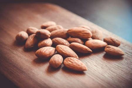 Fresh organic almonds on a wooden cutting board Standard-Bild