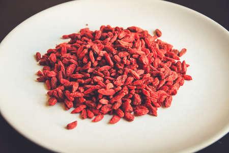 Goji berries in a white plate. Organic dried superfood