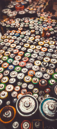 Old used batteries group. Top view vertical banner background.