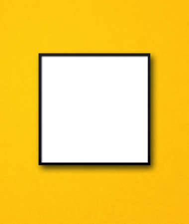 Black square picture frame hanging on a yellow wall. Blank mockup template