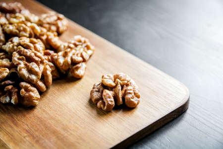 Walnut kernels on a wooden cutting board