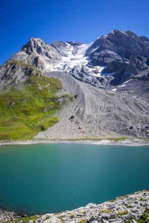 Long lake and Grande Casse Alpine glacier landscape in French alps Archivio Fotografico