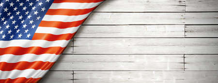USA flag on old white wall. Horizontal panoramic banner. Foto de archivo