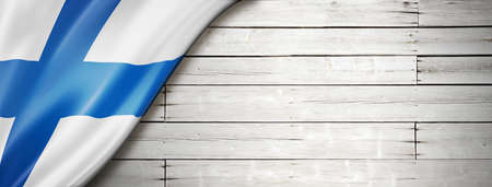 Finland flag on old white wall. Horizontal panoramic banner.
