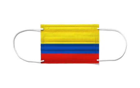 Flag of Colombia on a disposable surgical mask. White background isolated Archivio Fotografico