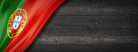 Portugal flag on black wood wall. Horizontal panoramic banner.