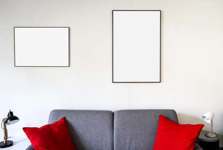 Blank picture frame on a sofa. Minimalist interior background