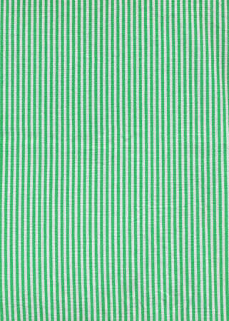 Green striped tablecloth background texture. Fabric wallpaper