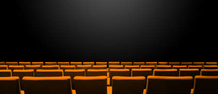Cinema movie theatre with orange seats rows and a black copy space background. Horizontal banner Archivio Fotografico
