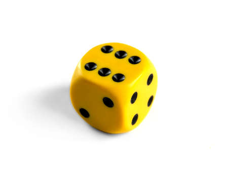 Yellow dice isolated on white background. Top view