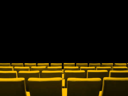 Cinema movie theatre with yellow seats rows and a black copy space background Archivio Fotografico