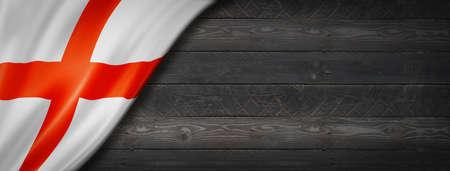 England flag on black wood wall. Horizontal panoramic banner.
