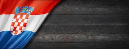 Croatia flag on black wood wall. Horizontal panoramic banner.