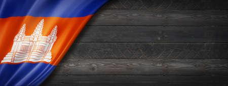 Cambodia flag on black wood wall. Horizontal panoramic banner. Archivio Fotografico