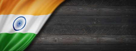India flag on black wood wall. Horizontal panoramic banner. Archivio Fotografico