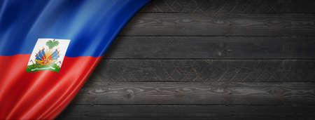 Haiti flag on black wood wall. Horizontal panoramic banner.