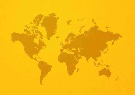 World map isolated on yellow wall background Archivio Fotografico