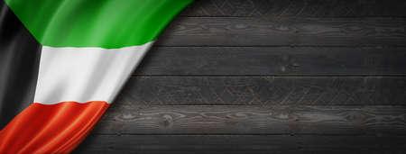 Kuwait flag on black wood wall. Horizontal panoramic banner.